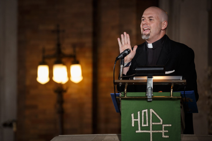 lutheran minister delivers sermon during a gay wedding