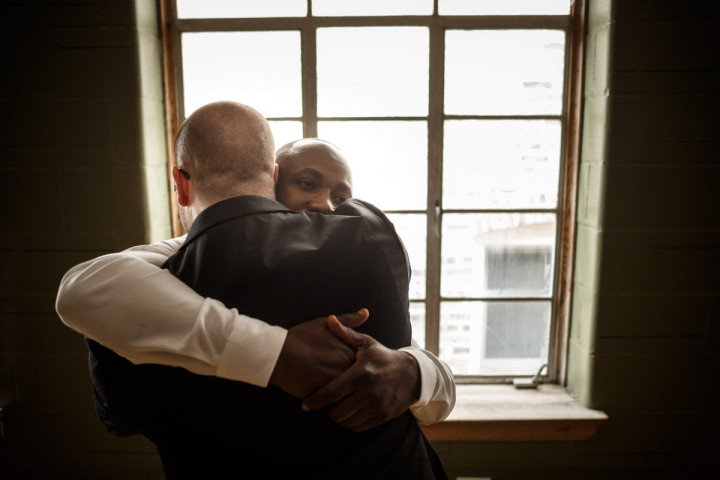 Chicago Gay Wedding Photographer captures grooms hugging before their wedding