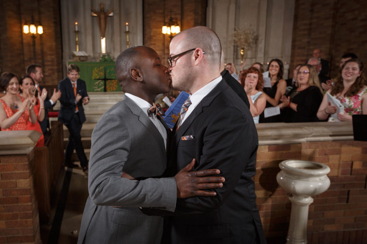 Gat grooms share their first kiss during their Chicago Lutheran Wedding