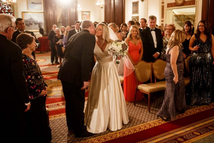 Chicago wedding photographer at union league club giving away the bride