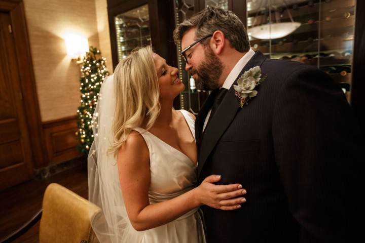 Chicago wedding photographer at union league club photography of couple kissing after the ceremony