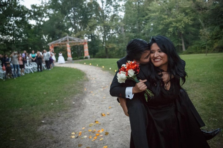 lesbian brides leave their wedding ceremony at the Redfield Estate at the grove in Glenview Illinois