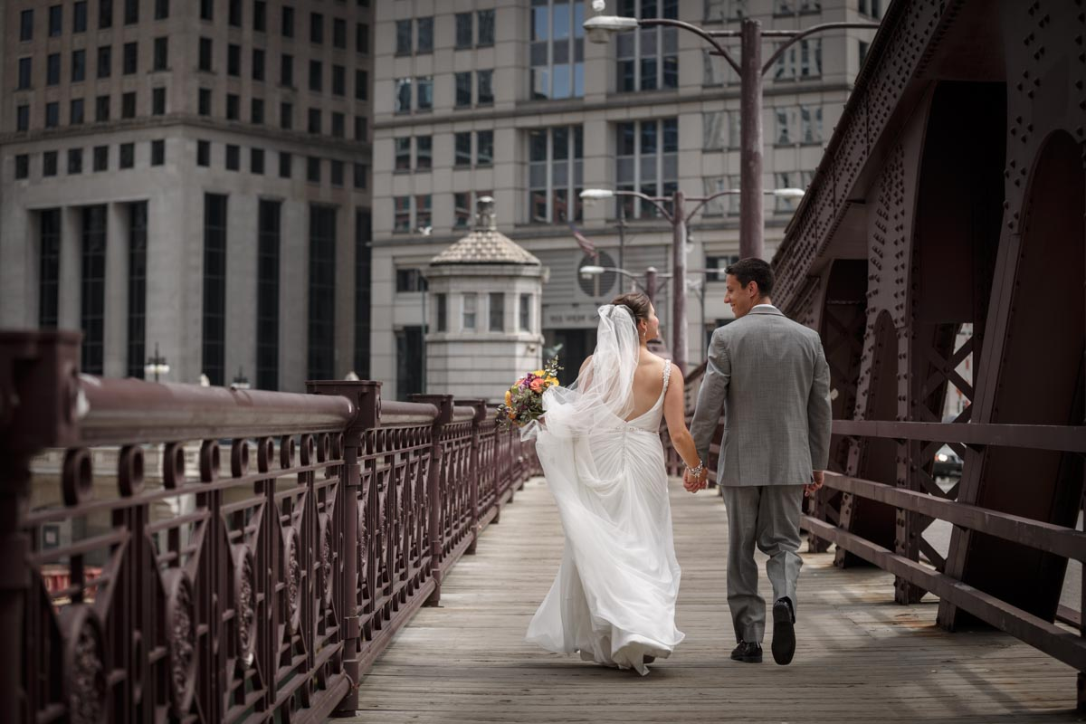 First look wedding photography on the Franklin Orleans Bridge over the Chicago River