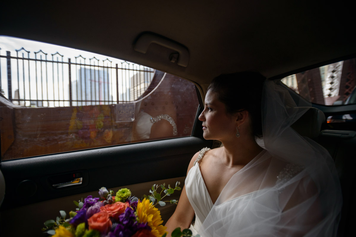 CHicago wedding photography bride in taxi cab