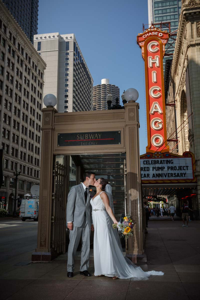 Portrait wedding photography on Statestreet with the chicago theatre sign by Photographer John Gress