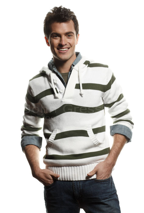 Compcard Photographer Chicago Male Model Troy Z laughs on white background studio image
