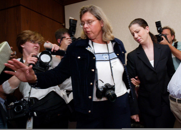 Audra Soulias (R), a former personal assistant to William Kennedy Smith, leaves a news conference with friend Gerd-Lind Kolarik in Chicago, August 26, 2004. Soulias is accusing Kennedy Smith, a nephew of Senator Edward Kennedy, who was acquitted in a highly publicized 1991 rape trial in Florida, of sexually harassing subordinates in a lawsuit. Smith, a 43-year-old doctor who helped found a global organization in 1996 that helps the disabled, denied the 5-year-old allegations in the lawsuit brought by Soulias August 25, 2004.