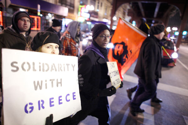Occupy Chicago protesters march in solidarity with anti-austerity protesters in Greece, as they march to the Greek Consulate in Chicago February 16, 2012. REUTERS/John Gress