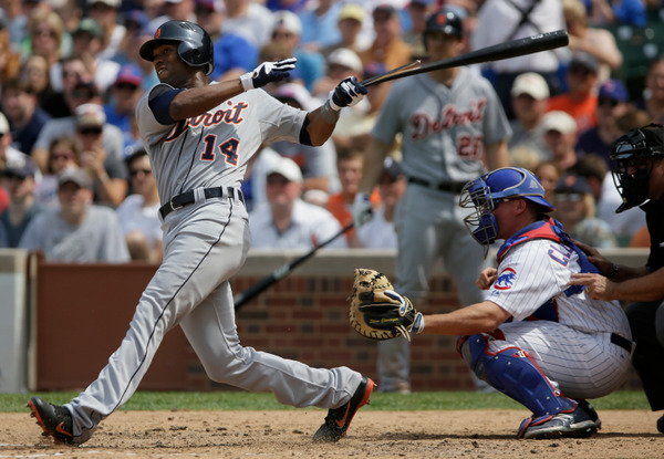 CHICAGO, IL - JUNE 14: Austin Jackson #14 of the Detroit Tigers hits RBI single as Steve Clevenger #51 of the Chicago Cubs looks on in the seventh inning of their MLB game at Wrigley field on June 14, 2012 in Chicago, Illinois. (Photo by John Gress/Getty Images)