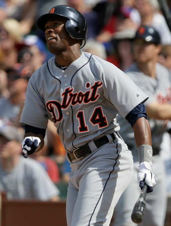 CHICAGO, IL - JUNE 14: Austin Jackson #14 of the Detroit Tigers hits a two-run home run off of the Chicago Cubs in the ninth inning of their MLB game at Wrigley field on June 14, 2012 in Chicago, Illinois. (Photo by John Gress/Getty Images)