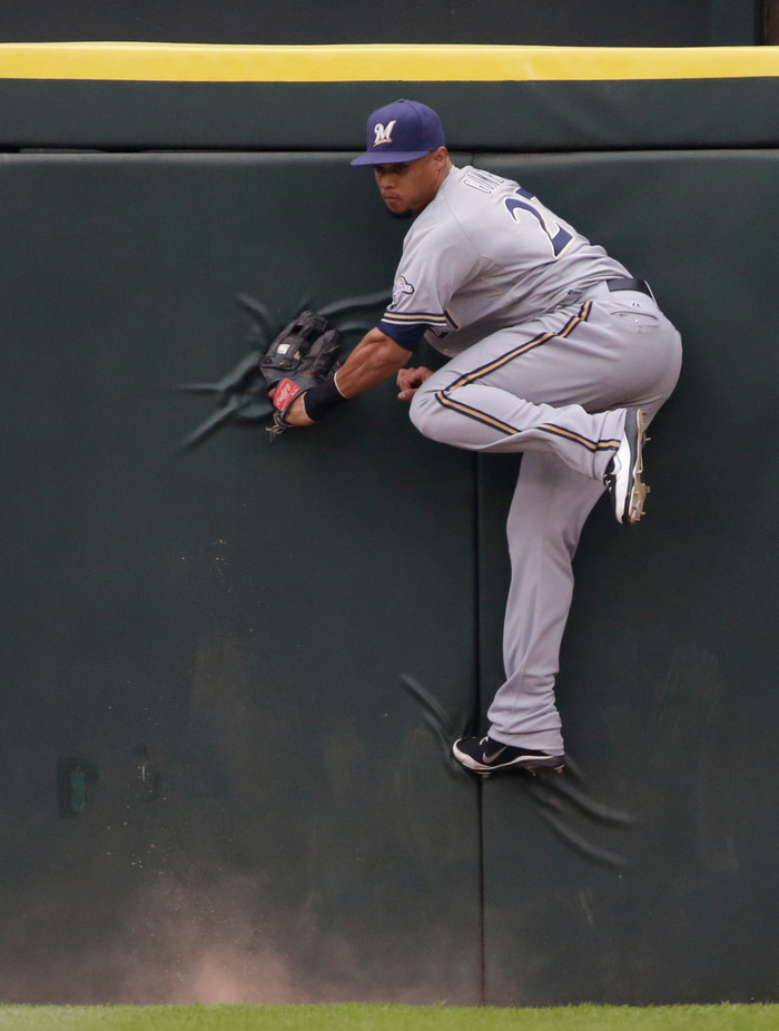 Carlos Gomez #27 of the Milwaukee Brewers catches a pop fly hit by Brent Lillibridge #18 of the Chicago White Sox  during their MLB game at U.S. Cellular Field on June 23, 2012 in Chicago, Illinois. The Tigers won the game 5-3. (Photo by John Gress/Getty Images)