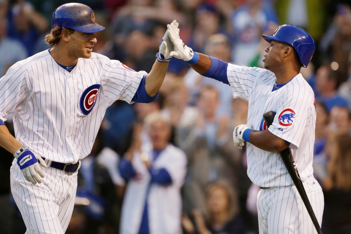 Joe Mather of the Chicago Cubs celebrates hitting a two run home run with teammate Luis Valbuena during the fourth inning of their MLB baseball game against the New York Mets in Chicago, June 25, 2012. REUTERS/John Gress