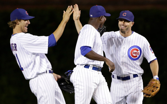 (L-R) Joe Mather of the Chicago Cubs, Alfonso Soriano and Reed Johnson celebrate defeating the New York Mets in their MLB baseball game in Chicago, June 25, 2012. REUTERS/John Gress