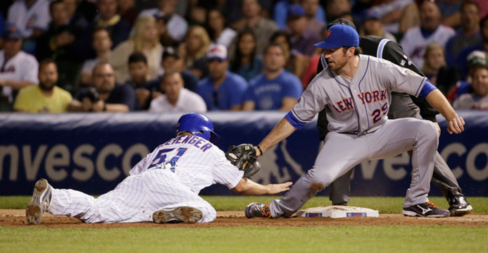 Ike Davis of the New York Mets tries to tag out Steve Clevenger of the Chicago Cubs during the eighth inning of their MLB baseball game in Chicago, June 26, 2012. REUTERS/John Gress
