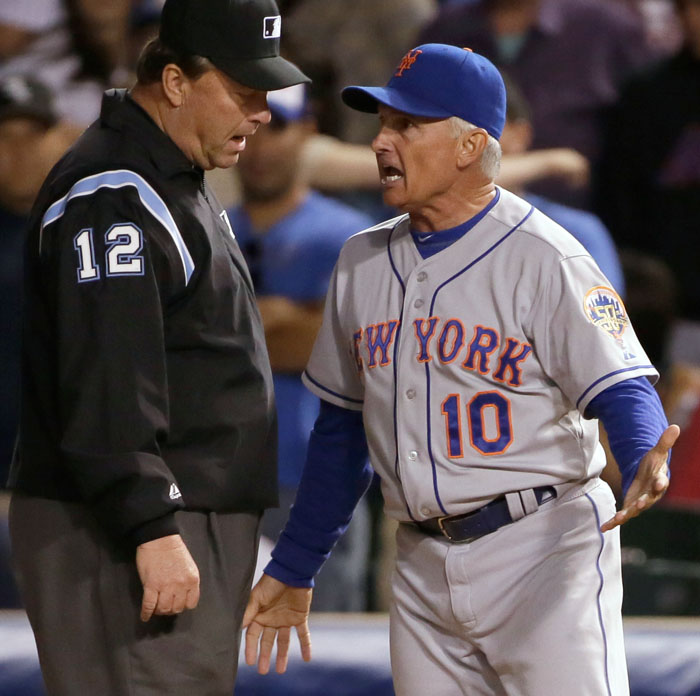 New York Mets Manager Terry Collins complains about a call at first base with umpire Gerry Davis during the eighth inning of their MLB baseball game in Chicago, June 26, 2012. REUTERS/John Gress
