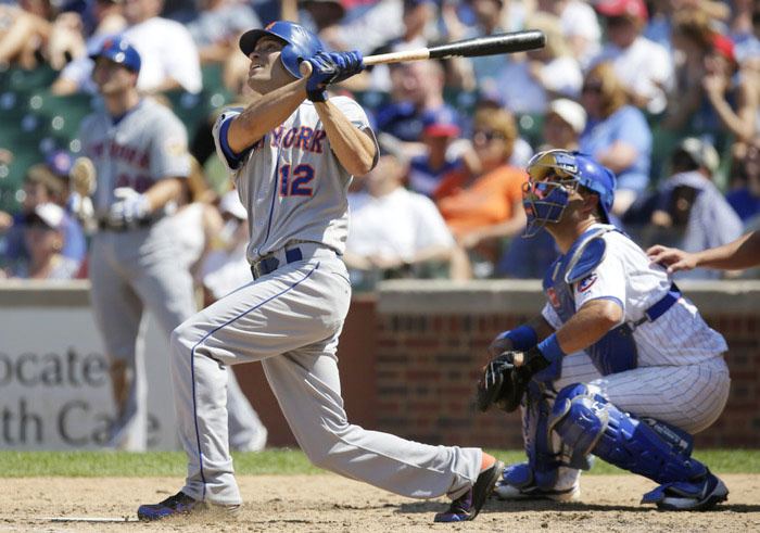 New York Mets Scott Hairston hits a grand slam home run off of the Chicago Cubs during the sixth inning in Chicago, June 27, 2012. REUTERS/John Gress