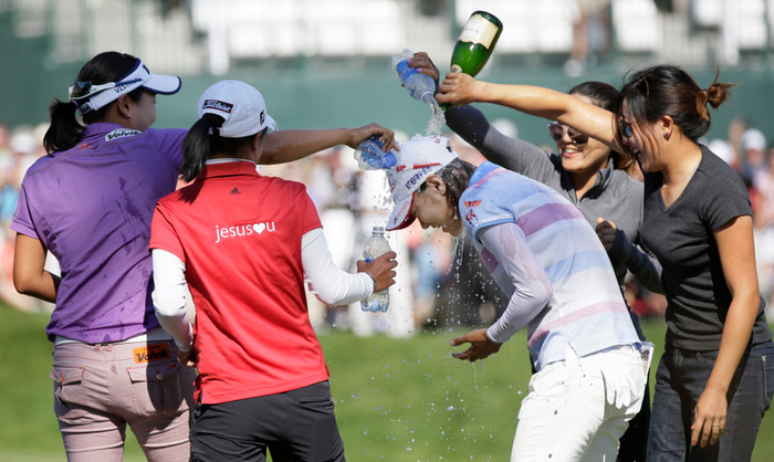 Na-Yeon Choi of South Korea is drenched in champagne and water by fellow golfers after winning the U.S. Women's Open golf tournament at Blackwolf Run in Kohler, Wisconsin July 8, 2012. REUTERS/John Gress