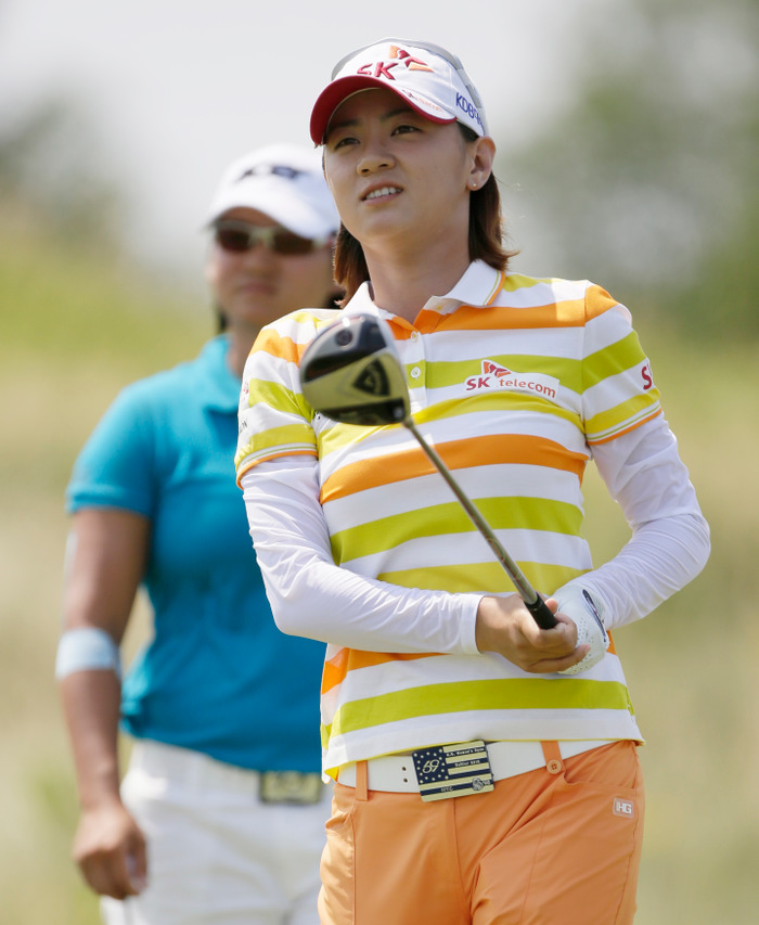 Na Yeon Choi of Korea drives from the third tee as Yani Tseng of Chinese Taipei looks on during the U.S. Women's Open golf tournament at Blackwolf Run in Kohler, Wisconsin July 5, 2012. REUTERS/John Gress