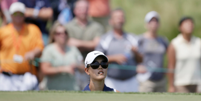 Michelle Wie of the United States watches her chip onto the second green during the third round at the U.S. Women's Open golf tournament at Blackwolf Run in Kohler, Wisconsin July 7, 2012. REUTERS/John Gress