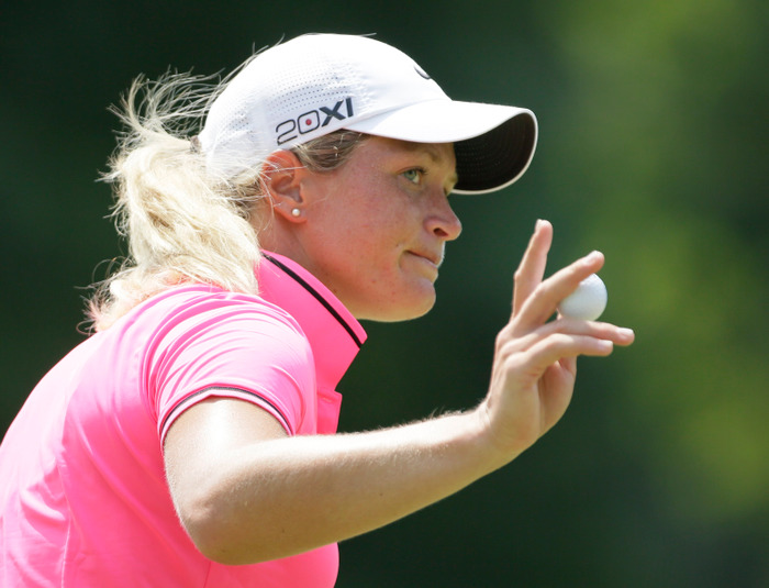 Suzann Pettersen of Norway acknowledges applause after putting on the ninth green during the second round of the U.S. Women's Open golf tournament at Blackwolf Run in Kohler, Wisconsin July 6, 2012. REUTERS/John Gress (UNITED STATES - Tags: SPORT GOLF)
