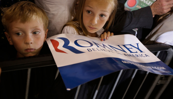 Young supporters of Republican U.S. presidential candidate Mitt Romney wait for an oppertunity to shake his hand as he campaigns at LeClaire Manufacturing in Bettendorf, Iowa, August 22, 2012. REUTERS/John Gress