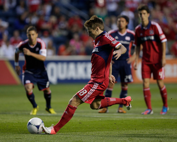 BRIDGEVIEW, IL - AUGUST 18:  Chris Rolfe #18 of the Chicago Fire scores a goal on the New England Revolution in the first half during their MLS match at Toyota Park on August 18, 2012 in Bridgeview, Illinois. (Photo by John Gress/Getty Images)
