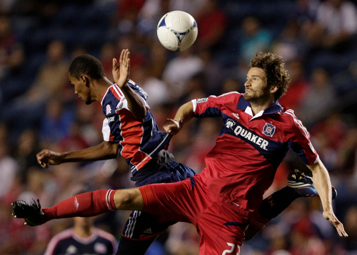 BRIDGEVIEW, IL - AUGUST 18: Arne Friedrich #23 of the Chicago Fire and Jerry Bengtson #27 of the New England Revolution struggle for the ball in the second half during their MLS match at Toyota Park on August 18, 2012 in Bridgeview, Illinois. (Photo by John Gress/Getty Images)