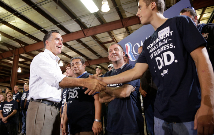 Republican U.S. presidential candidate Mitt Romney greets workers as he campaigns at LeClaire Manufacturing in Bettendorf, Iowa, August 22, 2012. REUTERS/John Gress