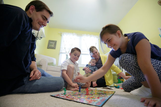 The de Groh family, Alex, 5-year-old Oliver, 3-month-old Montgomery, Molly and 9-year-old Avery at their home in McHenry, Ill.