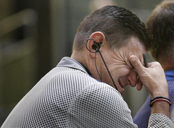 A trader in the Bond Options pits at the CME group in Chicago, September 13, 2012, reacts before the Federal Reserve launched another aggressive stimulus program on Thursday, saying it will buy $40 billion of mortgage-related debt per month until the outlook for jobs improves substantially as long as inflation. REUTERS/John Gress
