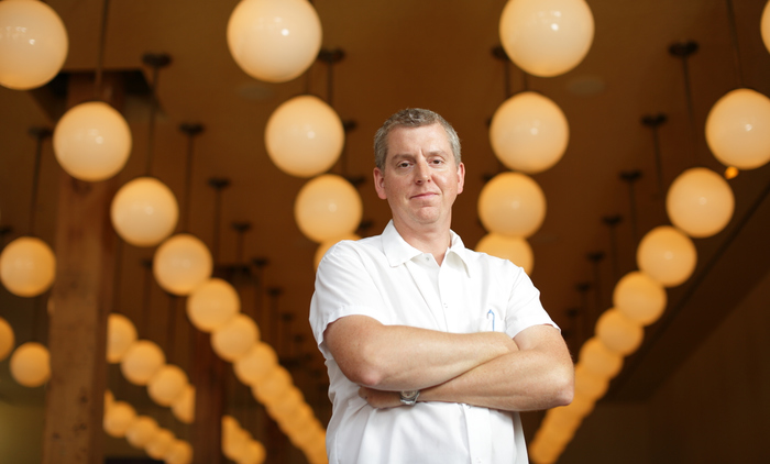 Publican Chef Brian Huston poses in his Chicago restaurant.