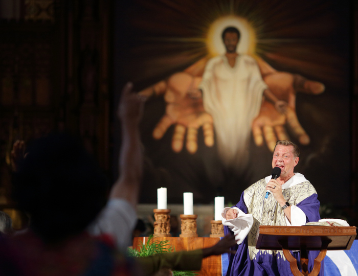 Rev. Michael Pfleger delivers his sermon at St. Sabina Catholic Church during the predominantly African-American congregation's Unity Mass in Chicago, September 2, 2012. REUTERS/John Gress