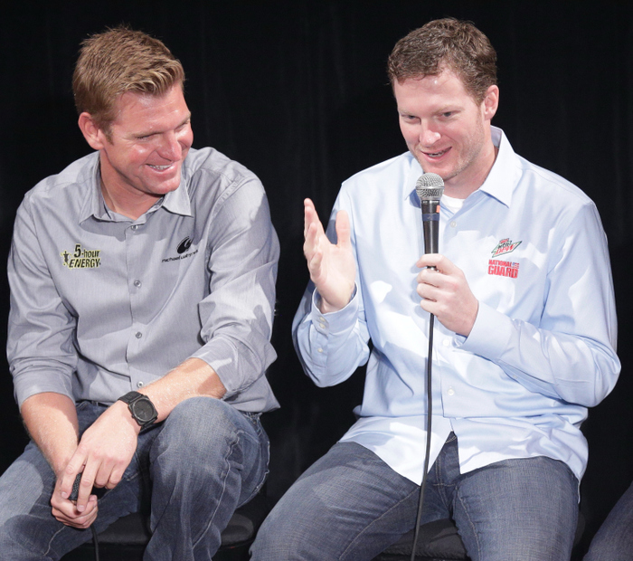 CHICAGO, IL - SEPTEMBER 12:  Driver Dale Earnhardt Jr.  speaks as  Driver Clint Bowyer looks on during the NASCAR Chase for the Sprint Cup Contenders Live show at the House of Blues September 12, 2012 in Chicago, Illinois.  (Photo by John Gress/Getty Images for NASCAR) *** Local Caption *** Dale Earnhardt Jr.;Clint Bowyer