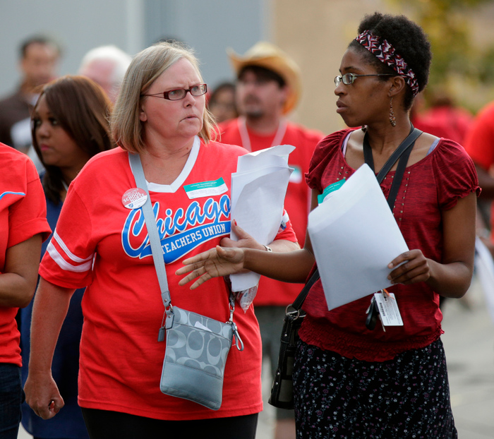 Chicago Teachers Union members leave a House of Delegates meeting on the seventh day of their strike in Chicago, September 16, 2012. REUTERS/John Gress