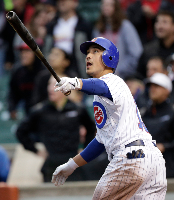 Chicago, IL - September 21:  Darwin Barney #15 of the Chicago Cubs hits a two run home run off of the St. Louis Cardinals in the ninth inning of their MLB game at Wrigley Field on September 21, 2012 in Chicago, Illinois. (Photo by John Gress/Getty Images)