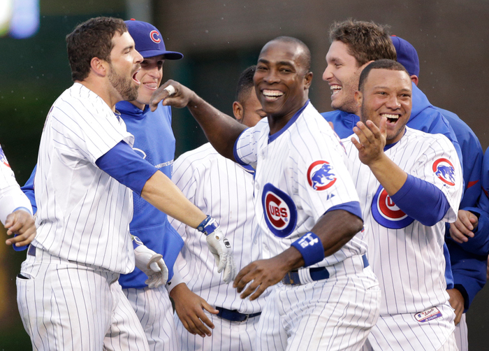 Chicago, IL - September 21: David DeJesus #9 of the Chicago Cubs celebrates with teammates including Starlin Castro #13 and Alfonso Soriano #12 after hitting a walk off RBI single off of the St. Louis Cardinals in the 11th inning of their MLB game at Wrigley Field on September 21, 2012 in Chicago, Illinois. (Photo by John Gress/Getty Images)