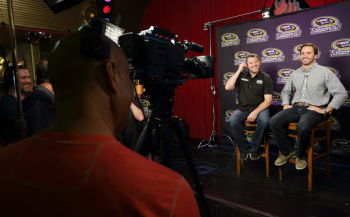 CHICAGO, IL - SEPTEMBER 12: Tony Stewart and Jimmie Johnson smile during an interview for ESPN at the Chase for the NASCAR Sprint Cup Media Day at the House of Blues September 12, 2012 in Chicago, Illinois. (Photo by John Gress/Getty Images for NASCAR) *** Local Caption *** Jimmie Johnson;Tony Stewart