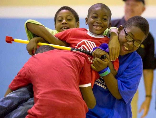 Bellwood, IL- SEPTEMBER 27: Kids from the BGCA get excited during activities for the Ryder Cup Outreach Program for the 39th Ryder Cup at Boys & Girls Club of West Cook County on September 28, 2012 in Bellwood, Illinois. (Photo by John Gress/PGA of America)