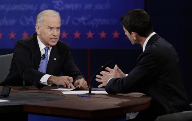 U.S. Vice President Joe Biden (L) debates Republican vice presidential nominee Paul Ryan (R) during the U.S. vice presidential debate in Danville, Kentucky October 11, 2012. REUTERS/John Gress (UNITED STATES - Tags: POLITICS ELECTIONS USA PRESIDENTIAL ELECTION)