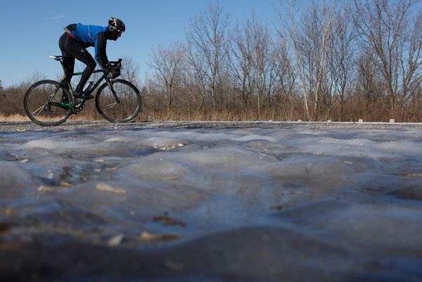 Christian Vande Velde rides his bike in Lemont, Illinois, January 5, 2009. John Gress / for The New York Times