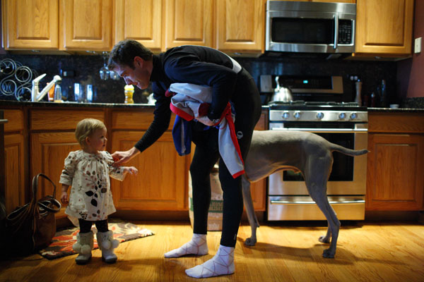 Christian Vande Velde greets his daughter Uma, 1, after a bike ride in Lemont, Illinois, January 5, 2009. John Gress / for the New York Times