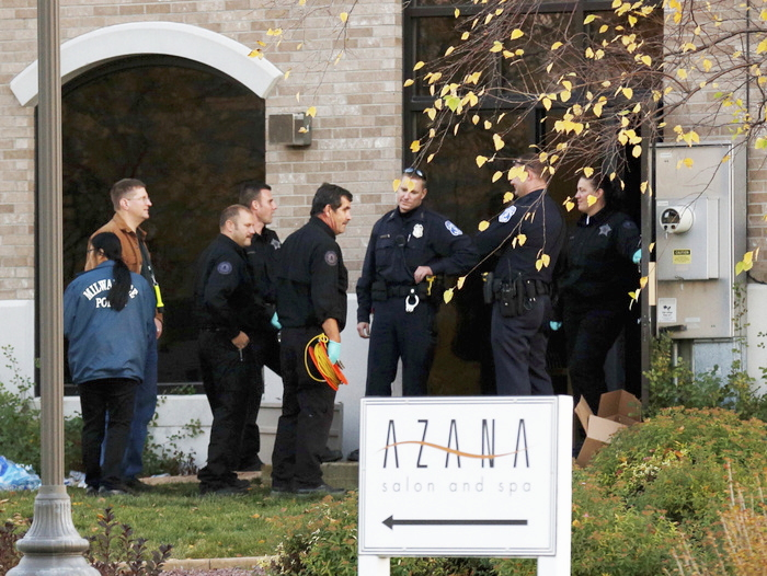 Investigators prepare to enter the Azana Salon and Spa in Brookfield, Wisconsin, October 21, 2012, where three people were killed and at least four injured in a shooting, Brookfield Police Chief Daniel Tushaus said at a news conference. REUTERS/John Gress (UNITED STATES)