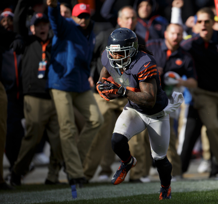 CHICAGO, IL - OCTOBER 28:  Tim Jennings #26 of the Chicago Bears heads down the field on his way to scoring a touchdown after pulling down an interception against the Carolina Panthers on October 28, 2012 at Soldier Field in Chicago, Illinois.  The Bears defeated the Panther 23-22. (Photo by John Gress/Getty Images)