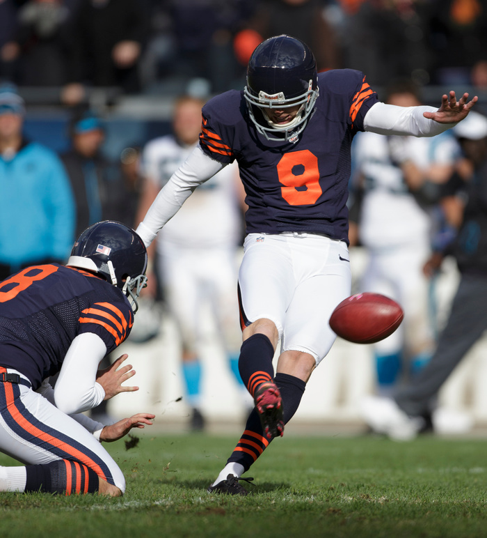CHICAGO, IL - OCTOBER 28:  Robbie Gould #9 of the Chicago Bears kicks the game winning field goal against the Carolina Panthers as teammate Adam Podlesh looks on at Soldier Field on October 28, 2012 in Chicago, Illinois. The Bears defeated the Panther 23-22.  (Photo by John Gress/Getty Images)