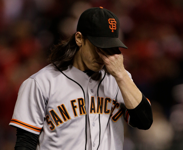 San Francisco Giants starting pitcher Tim Lincecum reacts after walking St. Louis Cardinals' Matt Carpenter in the first inning during Game 4 in their MLB NLCS playoff baseball series in St. Louis, Missouri, October 18, 2012. REUTERS/John Gress