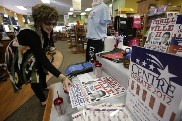 Beaverly Barry picks up a poster in Danville, Kentucky, October 10, 2012, commemorating the vice-presidential debate that will take place on Thursday night. REUTERS/John Gress