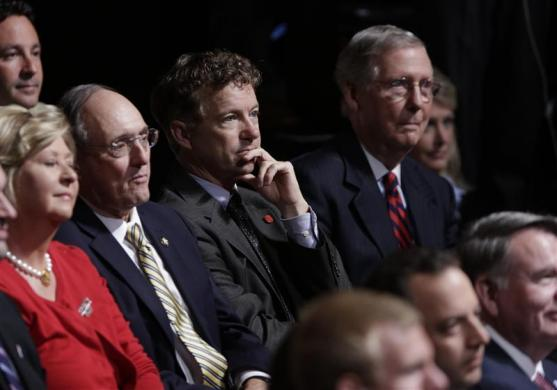 U.S. Senator Rand Paul (R-KY) (C) and U.S. Senate Minority Leader Mitch McConnell (R-KY) (at right) listen to U.S. Vice President Joe Biden and Republican vice presidential nominee Paul Ryan during the U.S. vice-presidential debate in Danville, Kentucky, October 11, 2012. REUTERS/John Gress