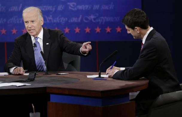 U.S. Vice President Joe Biden (L) points at Republican vice presidential nominee Paul Ryan during the U.S. vice presidential debate in Danville, Kentucky, October 11, 2012. REUTERS/John Gress