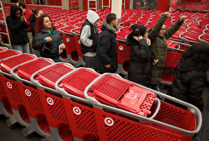 Black Friday shoppers file into a Target store in Chicago on November 22, 2012. Black Friday, the day following the Thanksgiving Day holiday, has traditionally been the busiest shopping day in the United States. REUTERS/John Gress