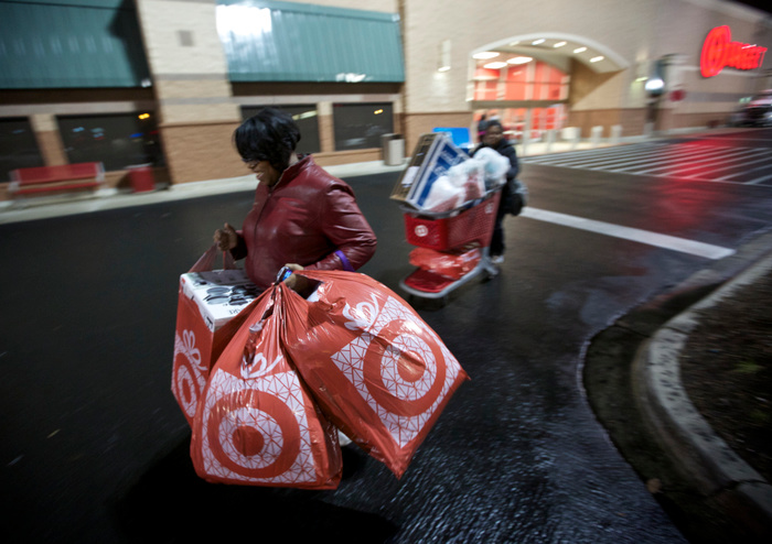 Black Friday shoppers leave a Target store in Chicago on November 22, 2012. Black Friday, the day following the Thanksgiving Day holiday, has traditionally been the busiest shopping day in the United States. REUTERS/John Gress